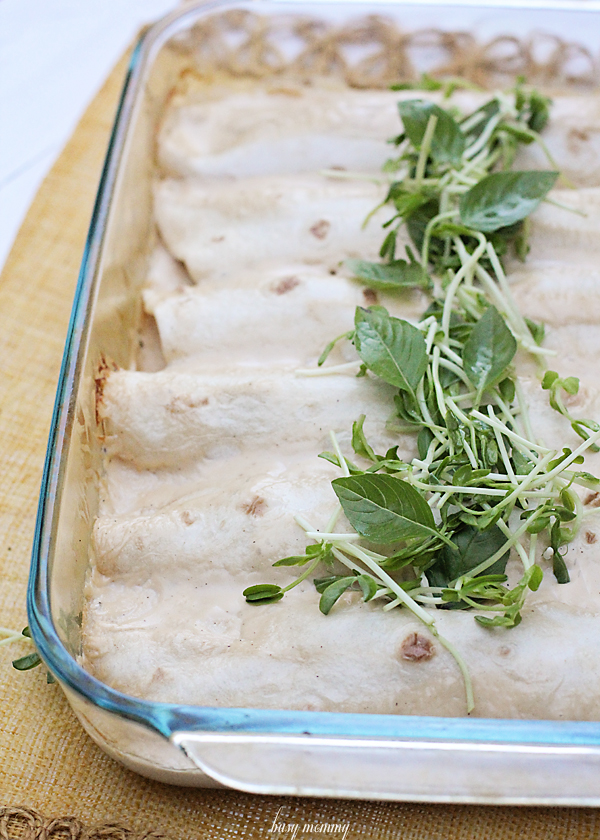 Spinach and Artichoke Dip Chicken Enchiladas. All of the ingredients of the addicting dish in a main meal!