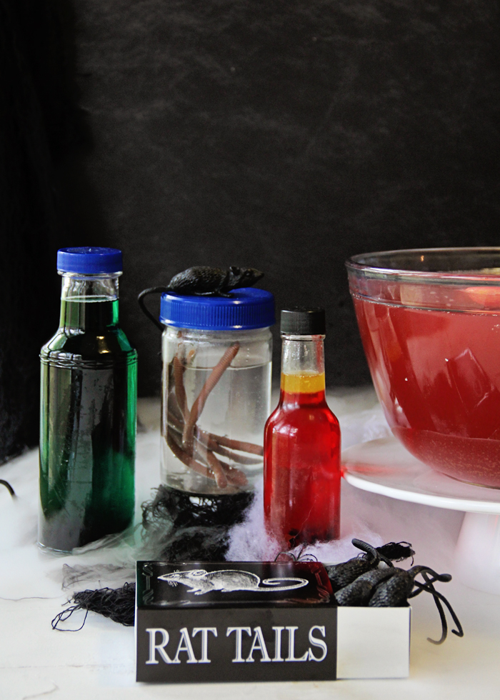 "Reuse glass jars for Halloween ""potions."" Fill them with food coloring and plastic bugs!"