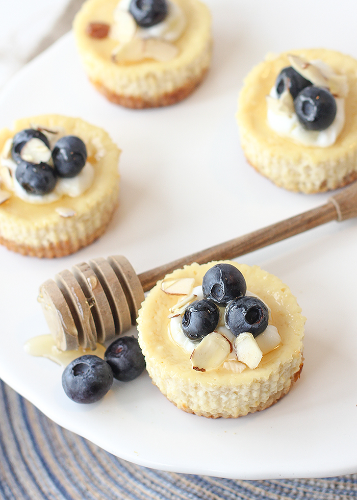 Almond Créme Mini Greek Yogurt Cheesecakes with blueberries and honey