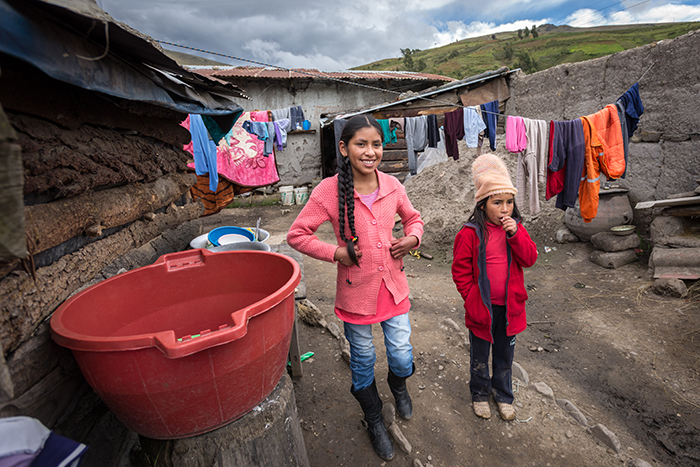 Child Sponsorship: (left) Rocio Lopez Orosco, 11, and her sister (right) Anabel Orosco, 7, in Colomi, Bolivia. They are newly sponsored children (since 2015). World Vision has been in her community just since 2010. ìWe have no light. No electricity. This is how we live,î Rocio says. Despite Bolivia being a country rich with resources, it is still one of the poorest countries in Latin America. Around 7 percent of the population is unemployed, and 45 percent is below the poverty line. Bolivia also has the highest income inequality in Latin America. Rocio's family currently does not have access to clean water at their home. They can not afford electricity. Large rocks on their tin roof prevent it from flying away in the wind (see photos D035-0268, D035-0269, D035-0259, D035-0258). World Vision's long-term work in Colomi, Bolivia is in the early stages. Over the next 10-12 years, through sponsorship, World Vision will help feed malnourished children, improve access to clean water, provide vocational training, provide nutrition training, and support schools with training and materials.