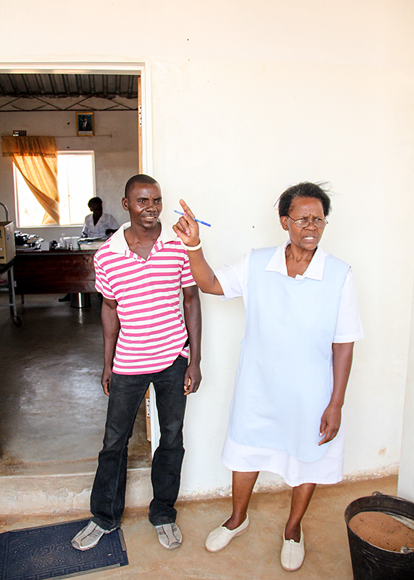 A community worker and nurse in Mululu, Zambia